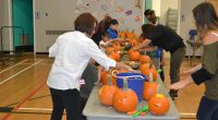 Students, parents and staff are having a great time carving pumpkins together. Save